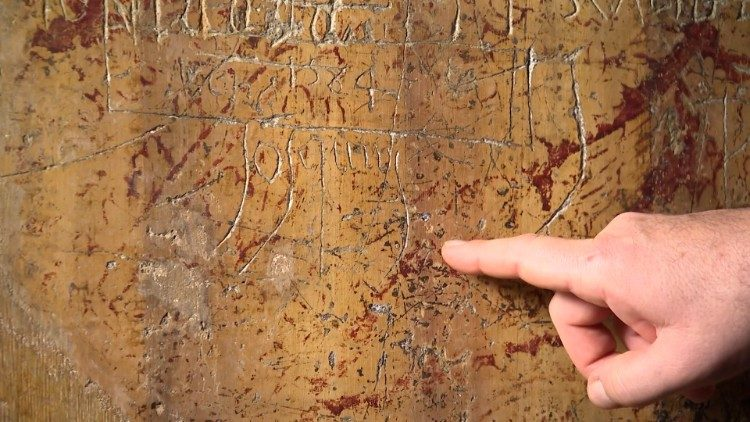 Maestro Marcos Pavan points out Josquin's probable signature in the graffiti found in the choir loft of the Sistine Chapel