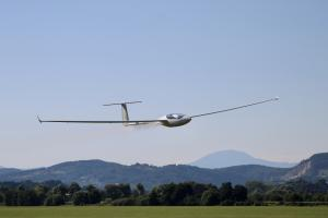 A glider flying over the ground